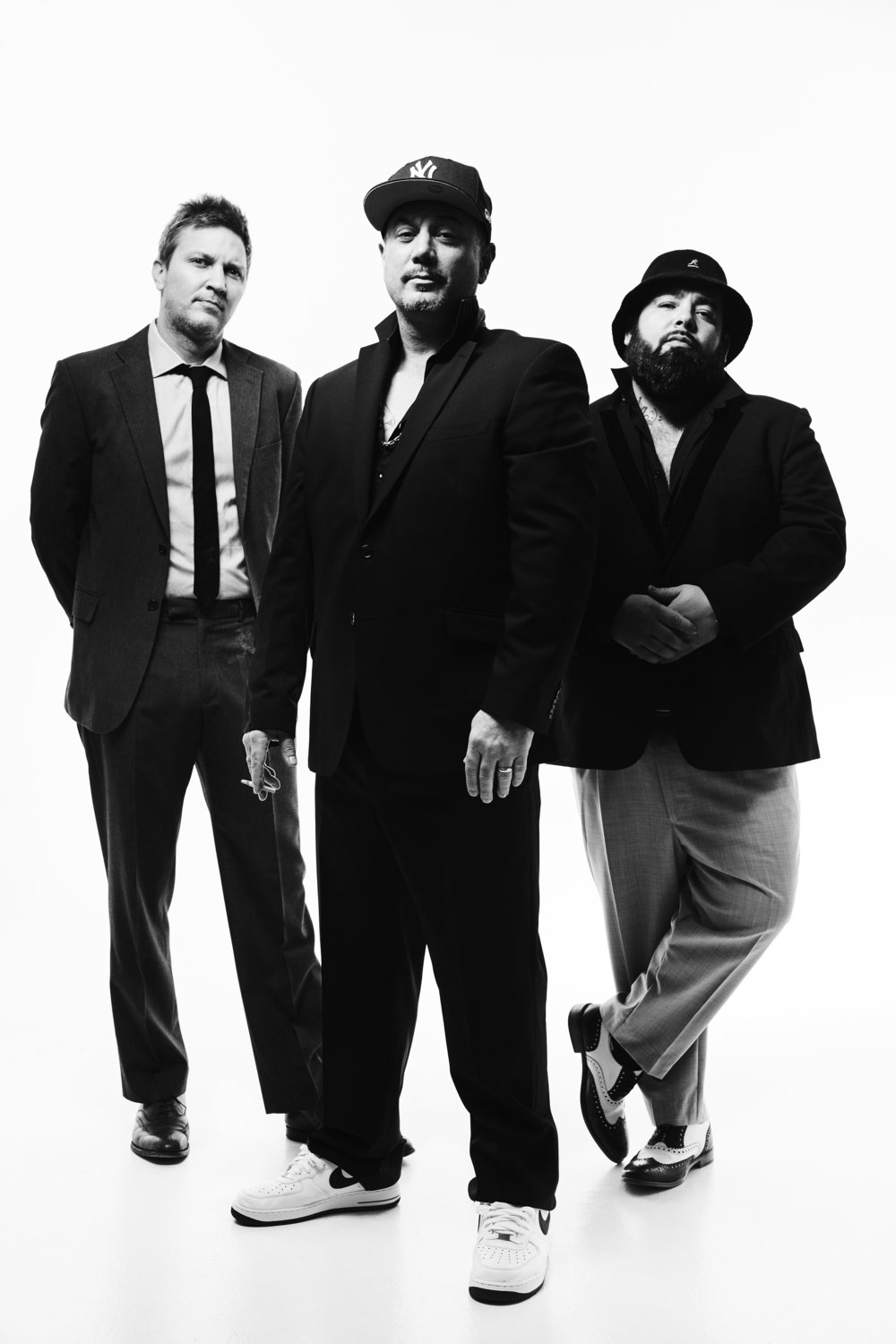 "FUN LOVIN' CRIMINALS   Est. 1993, NYC  They are, still, the world's finest and only purveyors of cinematic hip hop, rock 'n' roll, blues-jazz, latino soul vibes. The planet's best-loved ""cousins from New York"" who, through the mid-late 90s, chronicled life in their native city while bending the global ear to the sonic possibilities of exuberant hip-hop gangster-rock merged with lounge music, funk, mariachi trumpets and 'Bass-o-matic' Barry White. While possibly smoking a cheroot, in a sweat-dripped Puerto Rican nightclub, somewhere on the Lower East Side. Like The Killers and Kings of Leon today, the UK loved them first, the most; whip-smart story-tellers in smarter Saville Row suits, who told vibrant, satirical, comically tall tales of living large in the neon metropolis via music, drugs, crime and existential ennui. With a penchant for a beautiful ""lady"".    Formed in New York in 1993 by nightclub-working colleagues Huey and Fast, FLC gate-crashed the euphoric Brit-pop party in 1996 and brought along some unexpectedly unique swag, the generational classic album 'Come Find Yourself' which gave us the cackling refrain ""stick 'em up punk, it's the Fun Lovin' Criminal"" and the Pulp Fiction–sampling 'Scooby Snacks', the Valium assisted stick-up stunner with its immortal refrain, ""Runnin' around, robbin' banks, all whacked on the Scooby Snacks"". Huey, at 27, was already an ex-con and Desert Storm marine veteran, a charismatic New York smooth-talker with Irish/Puerto Rican roots and immaculately tended goatee. Girls, you might say, responded. The mid-to late 90s was a twirling martini cocktail of world travel, acclaim and phenomenal album sales, including three weeks as support on the U.S PopMart tour with U2 in 1997 (Huey refers to Bono as ""rich Uncle Paul""), through second album '100% Columbian' (1999, featuring their Barry White eulogy 'Love Unlimited') and the early 2001 release of third album 'Loco.' ""1995 to 2002 was living the dream for us,"" smiles Fast. ""It was just non-stop fun. We were out on tour for seven years, we lived it and we don't have any regrets.""    FLC released the albums 'Welcome To Poppy's' in 2003 and 'Livin' In The City' in 2005. The last studio album released was 'Classic Fantastic' in 2010. 2011 saw the release of their triple live album 'Fun, Live, and Criminal'. The band released a live concert film titled 'The Bong Remains The Same' in 2014 featuring 26 live songs from a performance at Shepherds Bush Empire in London on their 2010 Classic Fantastic tour. September, 2015 will mark the 20th anniversary of the bands first ever live shows at The Tunnel nightclub in New York City. A world tour is currently being setup to celebrate 20 years of FLC. The band will be performing their debut album 'Come Find Yourself' in full from start to finish.    Their reputation as a live band spectacular grew, which resonates today - ""anybody who ever plays after us at a festival really does not like that spot,"" guffaws Huey – playing Glastonbury 2008 (on the Jazz Word Stage) to thunderous reception. ""The guy who ran the Jazz/World stage at Glastonbury,"" says Huey, ""told us, 'there were 40,000 people watching your set, whoever was on after you and had half that'. There's still people who know. If they're looking at the flyer at a festival, 'Dude! Fun Lovin' Criminals are playing in a half hour.' And those are our people. To get to them is why we make music.""    The trio, now all relocated to the UK have left the cartoon New York netherworld behind for a colossal outdoors party, creating self-produced classics recorded in their London studio's featuring life-long ""fourth member"", the Grammy-award winning hip-hop engineer Tim Latham ISP (A Tribe Called Quest, De La Soul, Lou Reed, Citizen Cope…and Britney Spears). ""Well, we're still guys from New York,"" grins the incorrigible Huey. ""We keep in the forefront of our minds that any day above ground is a good day. That's No.1. No.2, you've got the love of your friends and family. No.3, you have to laugh a little during the day. No one's planting a flag here, no-one's curing cancer but you have a hard week, you get home, whatever your poison is, have a glass of wine, smoke your spliff and go, 'phew, I'm glad that's over' - that's what we're here for. For that exact moment when you can just put aside everyday bullshit."