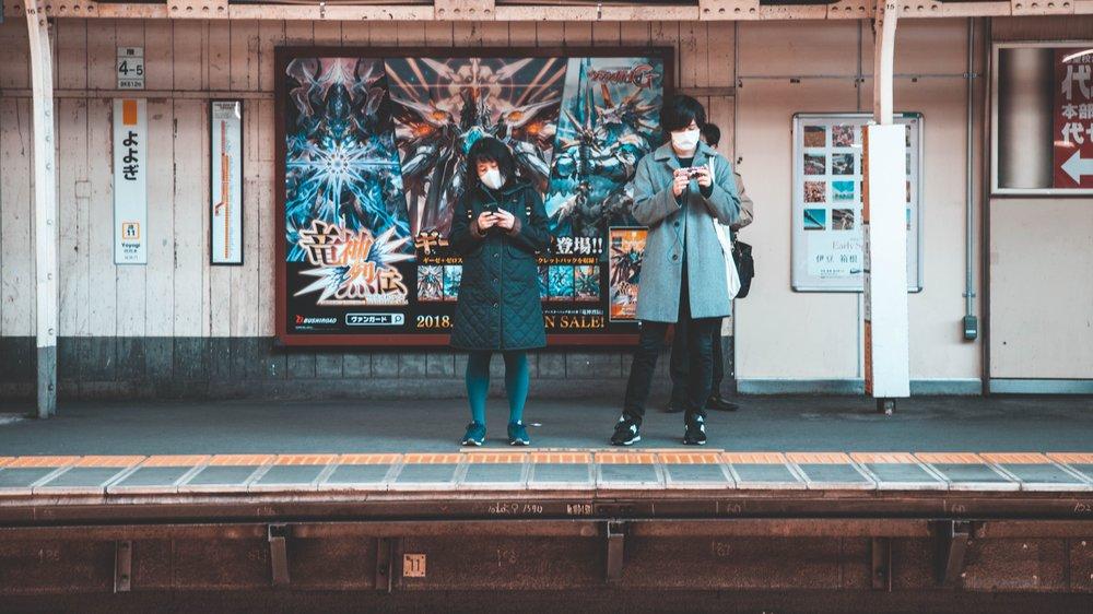 tokyo couple masks at station