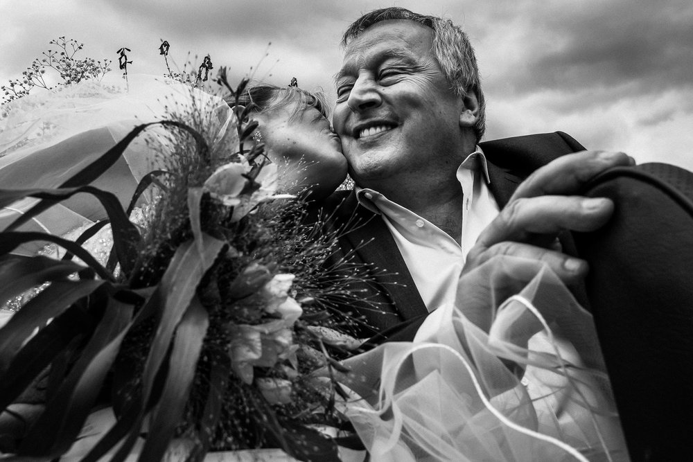 dad gets emnotional at the wedding of his daughter