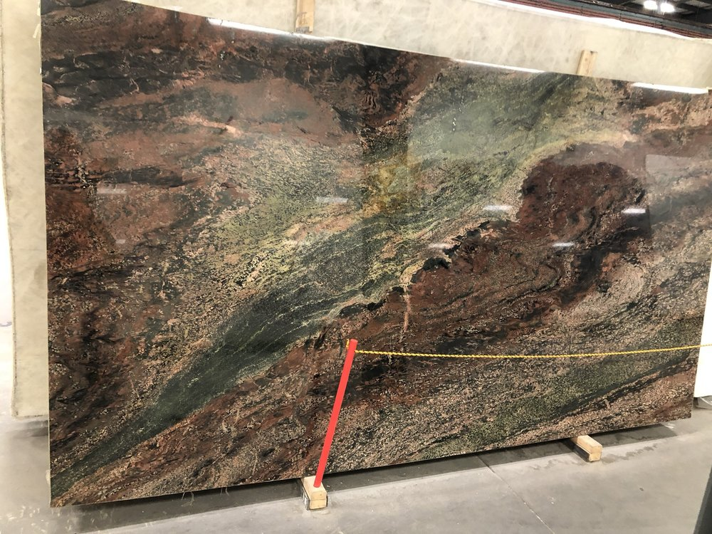 Verde Fuoco Granite Slab as focal point in kitchen remodel