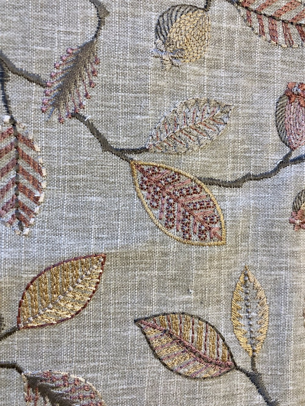 Linen embroidered fabric for window treatments pulls the new look together