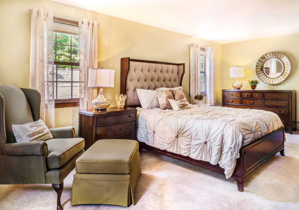 The bedroom has a linen upholstered shelter bed, bachelor chest, 3 drawer nightstand and dresser.
