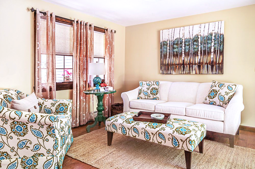 A light linen sofa was paired with a comfortable club chair in mojito fabric of teals and greens.