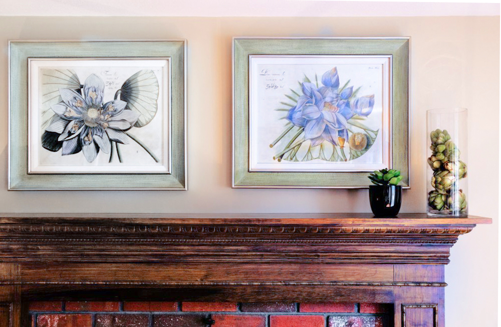 Blue lotus linen matted pictures were placed above the fireplace.