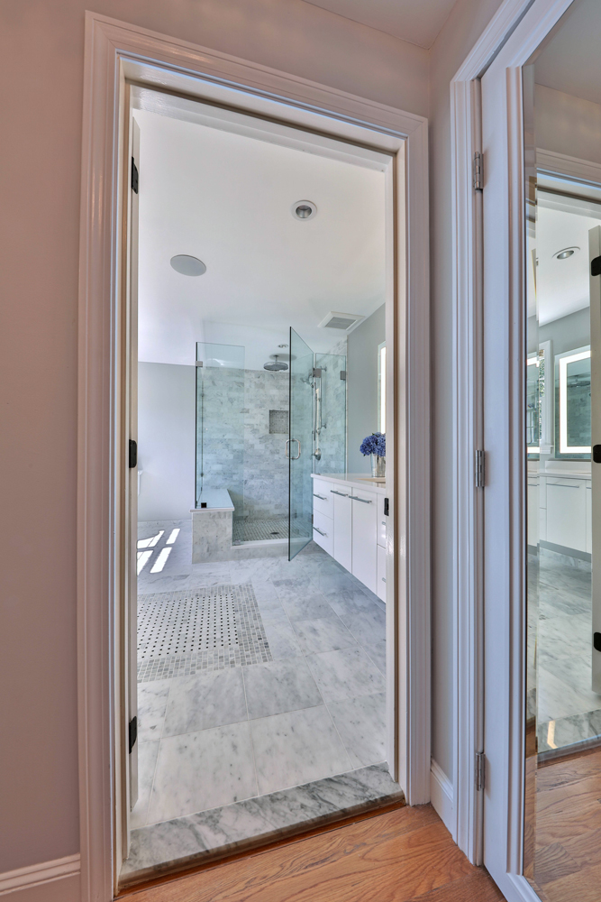 This bath also has electric radiant floor heat, LED downlighting, and Panasonic exhaust fans.