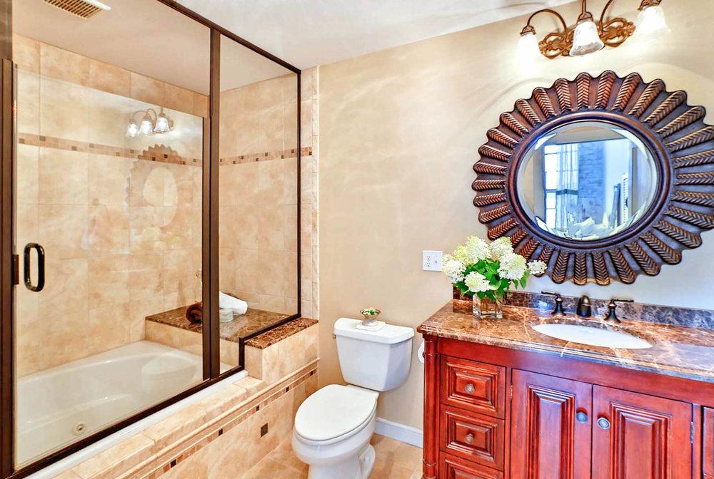 A bathroom design with marble vanity top.