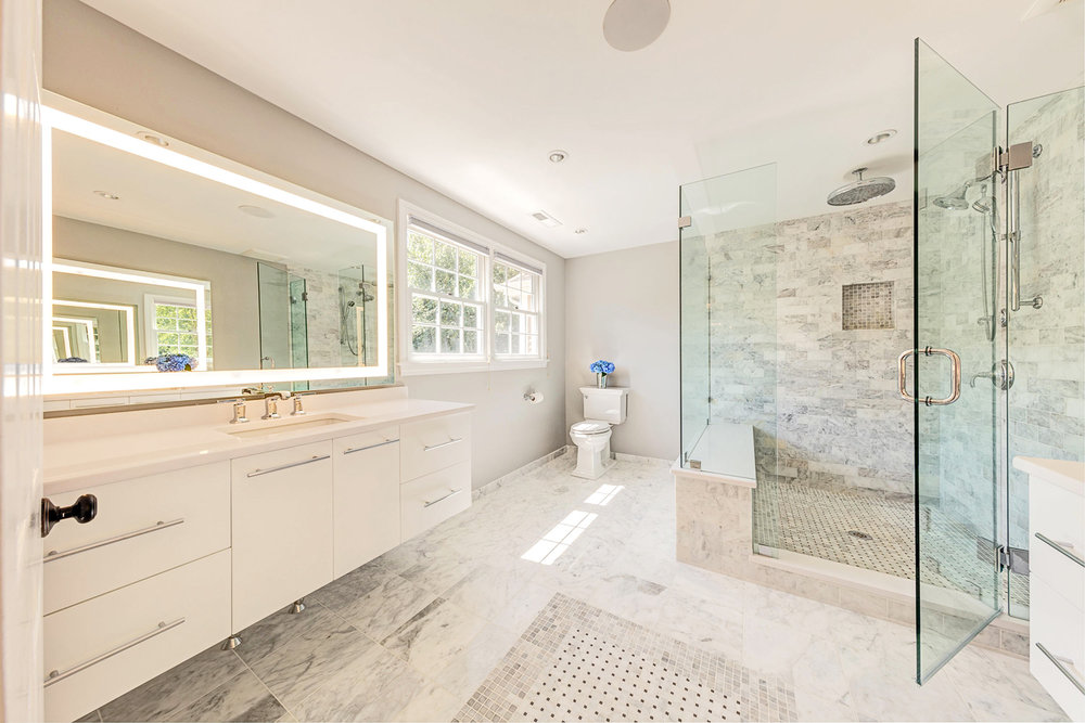 Carrera marble in a basket weave pattern was used for both the bathroom and shower floor.