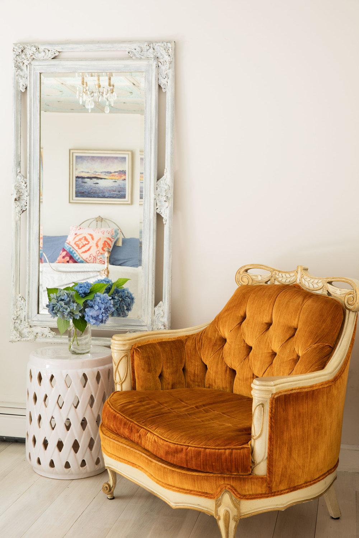 Vintage French Provincial button tufted orange velvet chair.
