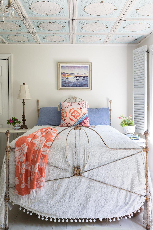 A vintage iron bed and an heirloom Martha Washington bedspread.