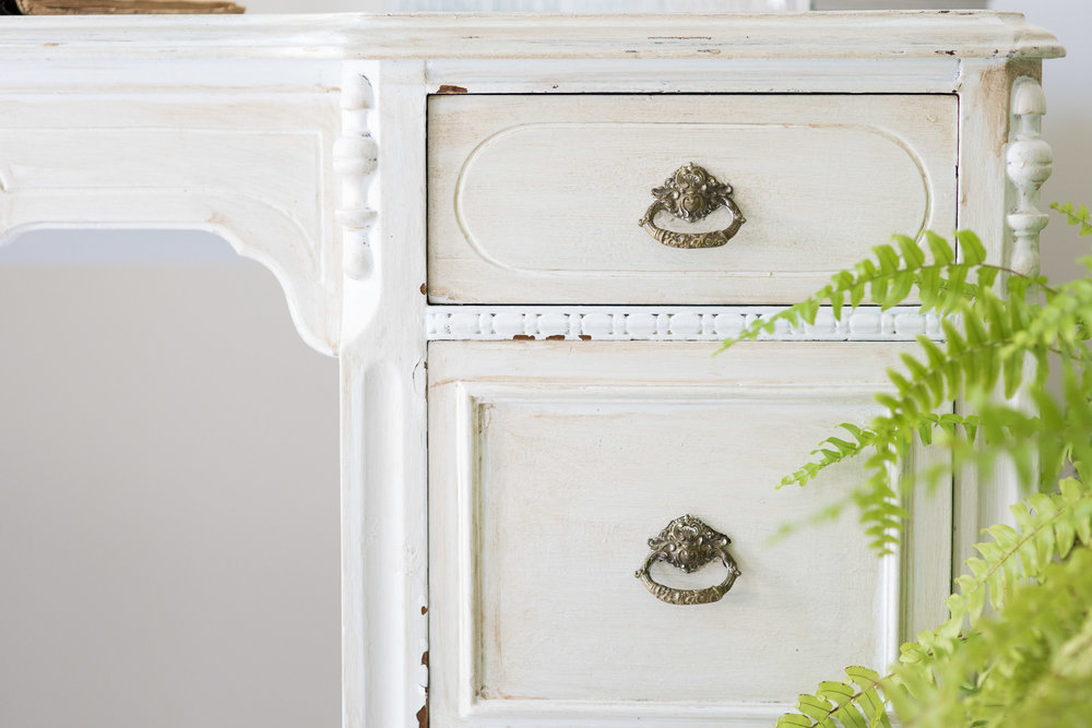 The writing desk was originally painted in olive green. Dry brushing was applied for a distressed lighter feel.