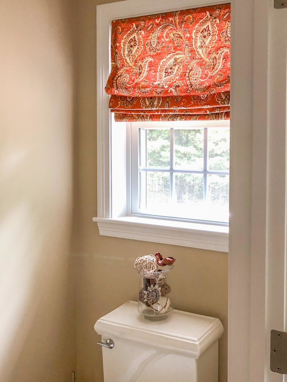 A small powder room was designed for the space.