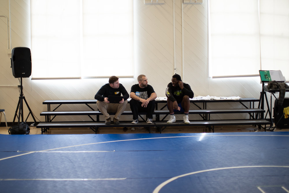 From left to right: Head Coach Allen Loretz, Director Daniel McCune, and Assistant Coach Denzel Mabry (photo by Leonardo Flores).