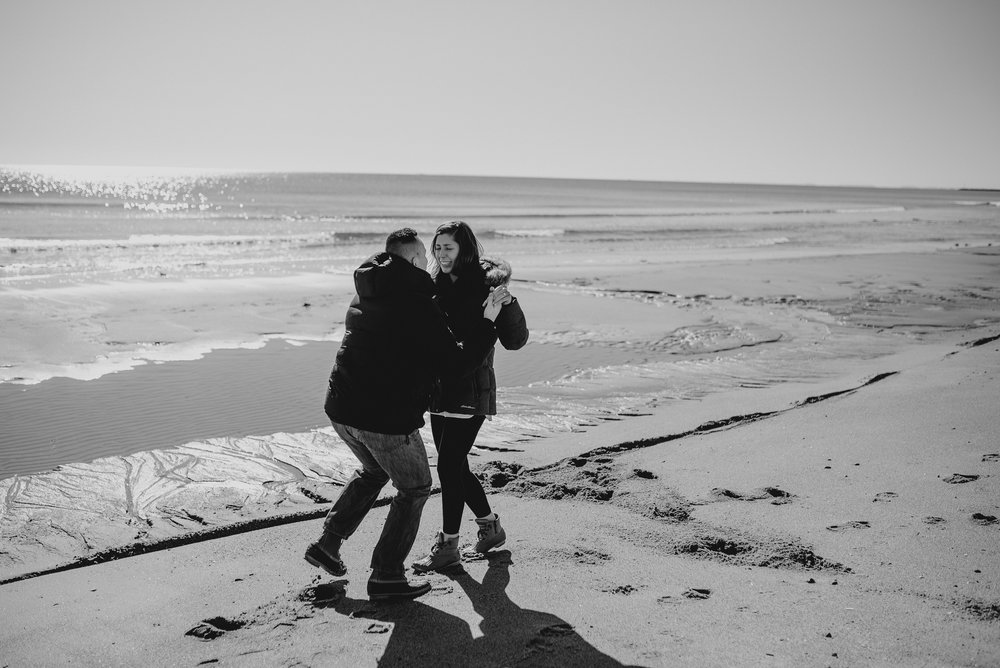 Her face says it all! Engaged (Hampton Beach, NH)