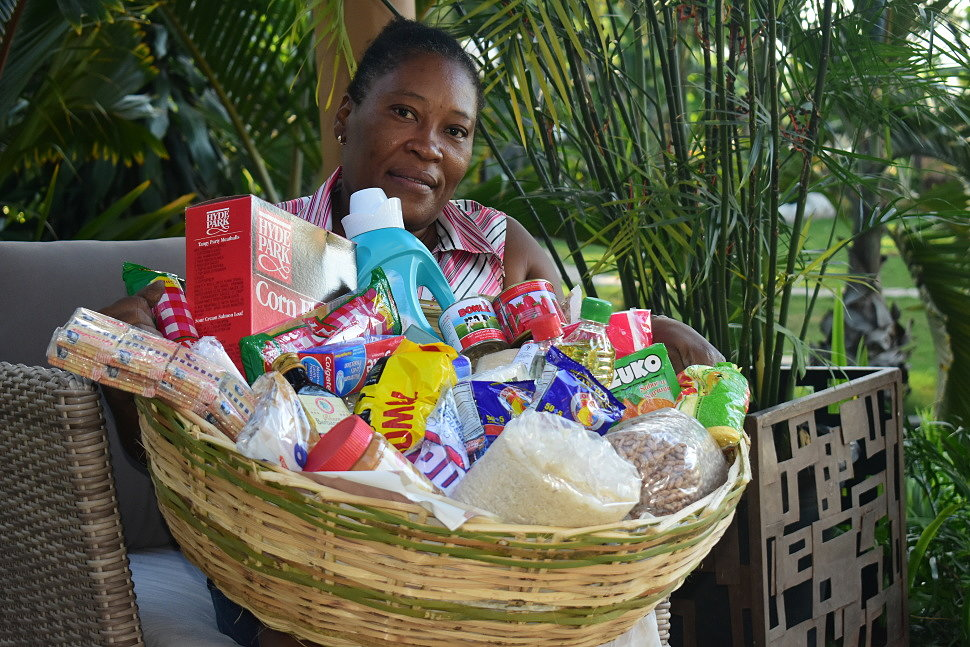 Marie Jeanne Momplaisir with one of the baskets.