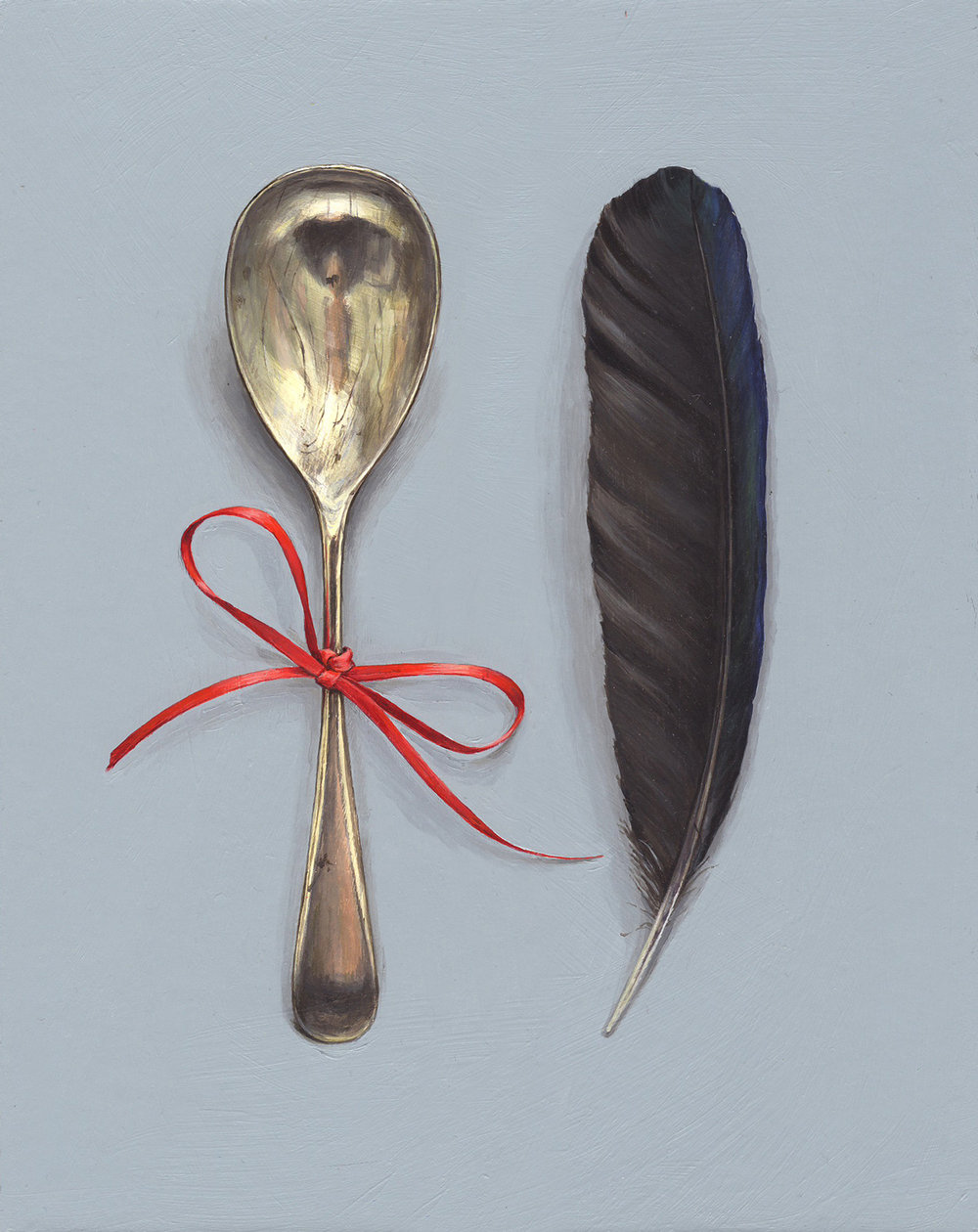 feather with spoon and red ribbon