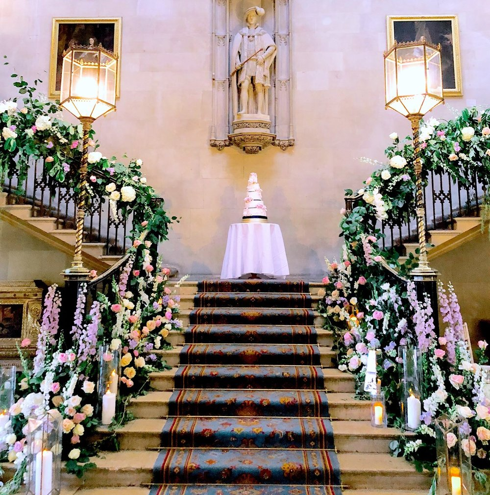 The grand staircase dressed with English garden flowers - pink delphinium, foxglove, garden roses, white hydrangea, scented stocks and tons of foliage