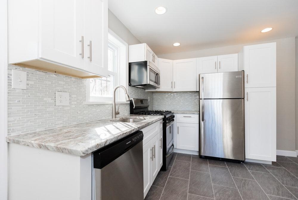 Germantownsingle family - Single family corner property gut rehab with brand new kitchen, bath, flooring, parking.
