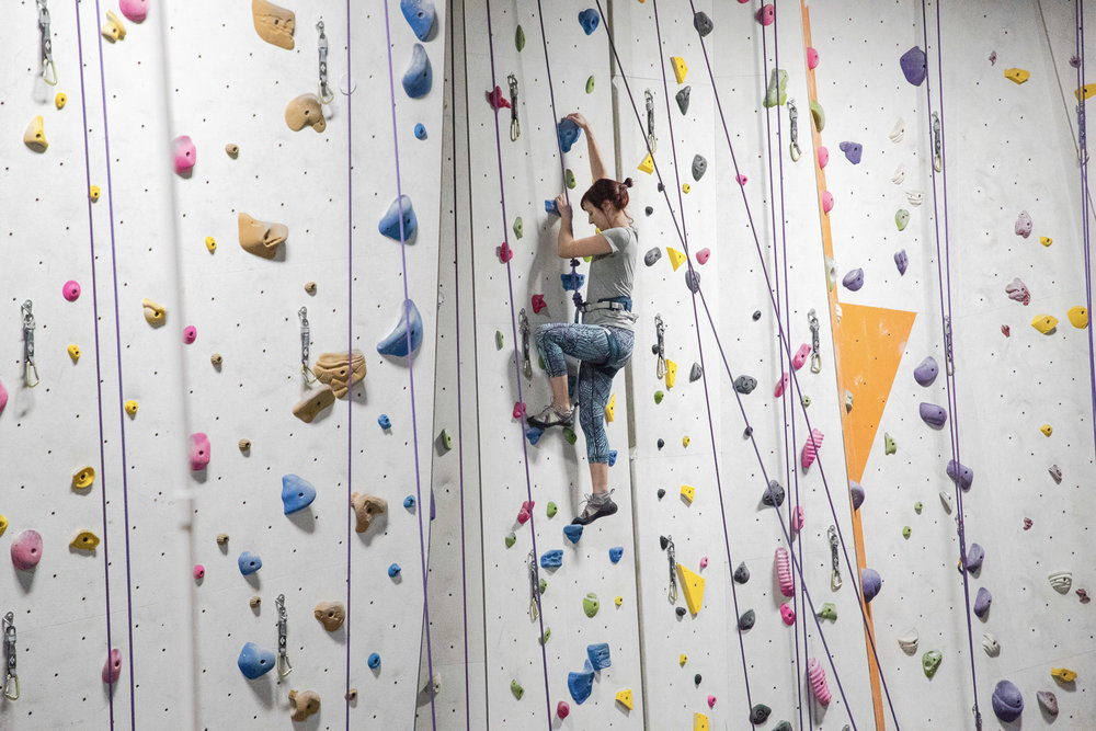 Roped Climbing - Our roped walls are open to climbers who know how to belay (control the rope for a climber). Take a class or take a test (no appointment needed) to get belay certified at The Cliffs.