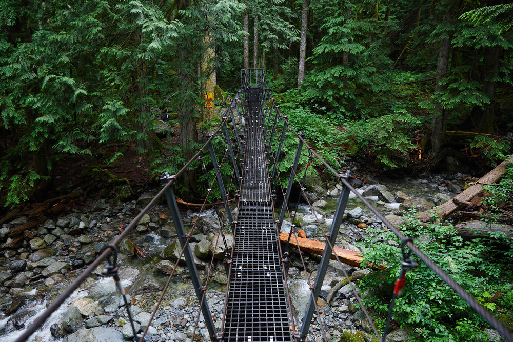 After the waterfall, you cross a wire bridge and continue into the valley.