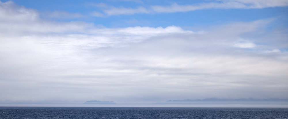 From across the water you can see Olympic National Park in the USA.
