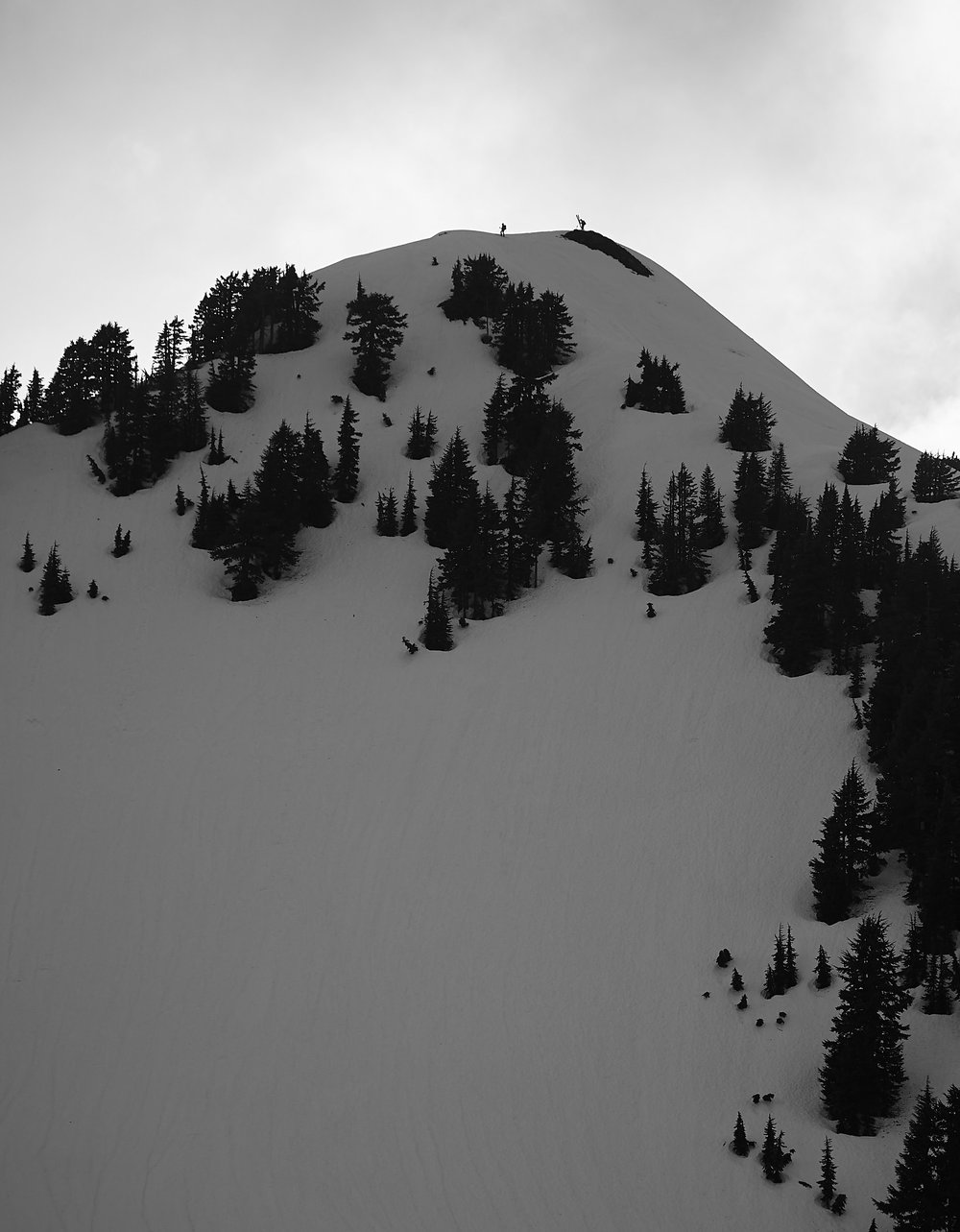 Two of the people staying in the hut can be seen here at the top of nearby peak ready to ski down.