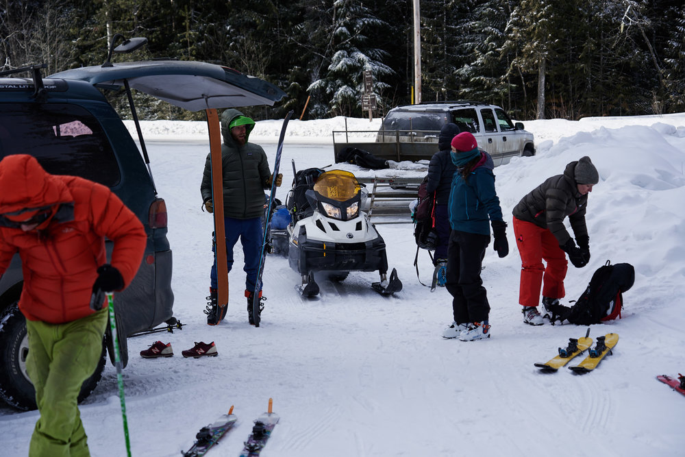 The snow cat was parked just around the bend from the parking lot, so we loaded up all of our stuff in the snow mobile and began skinning up.