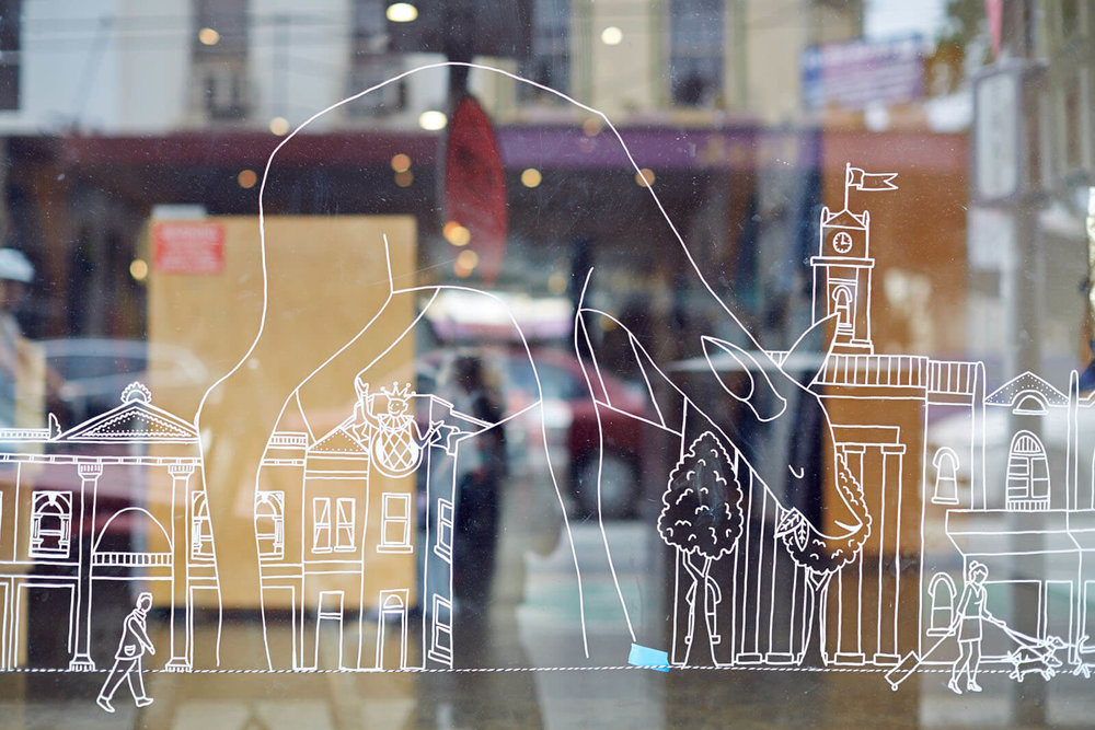 art town window mural for designer space, Prahran