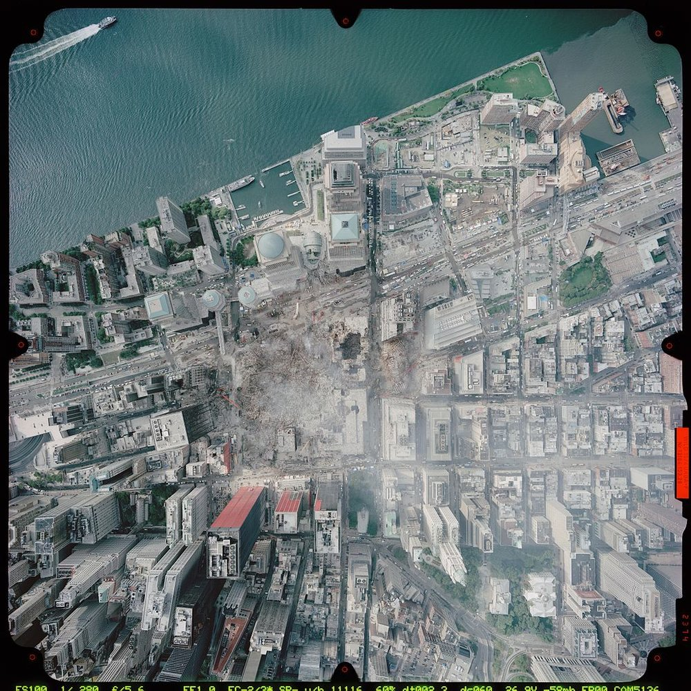 Arial view of the destroyed World Trade Center, informally renamed Ground Zero, after the 9/11 attacks. (NOAA Photo)