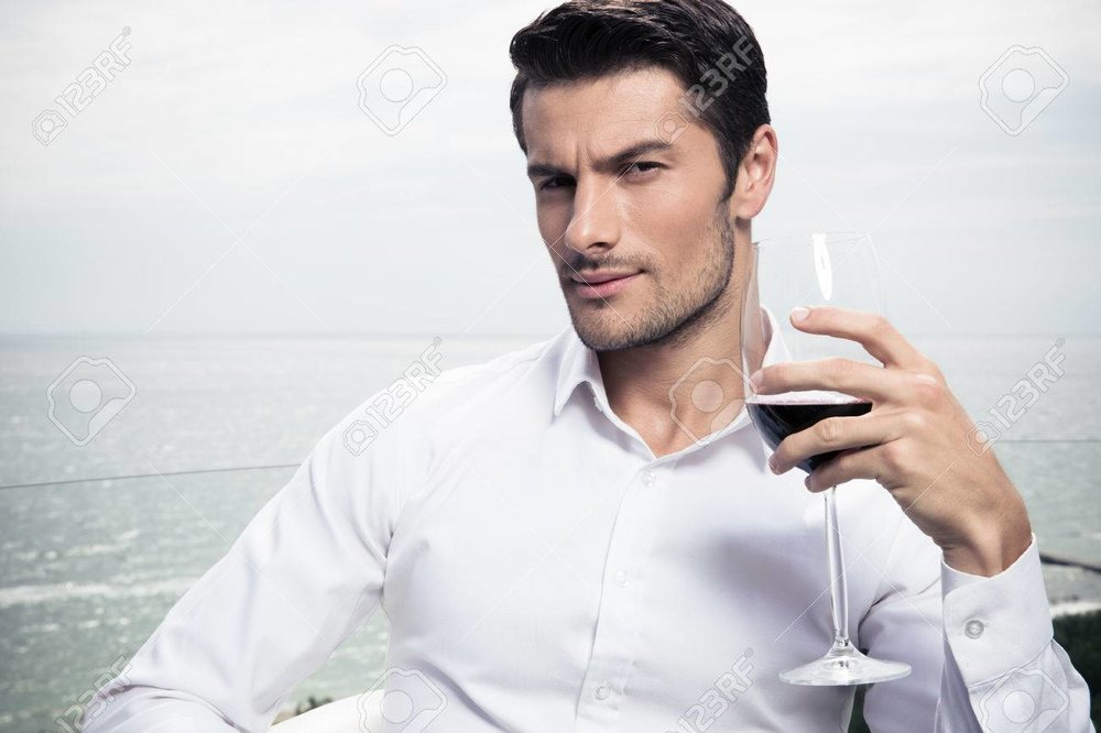 44401443-handsome-young-man-drinking-wine-outdoors.jpg