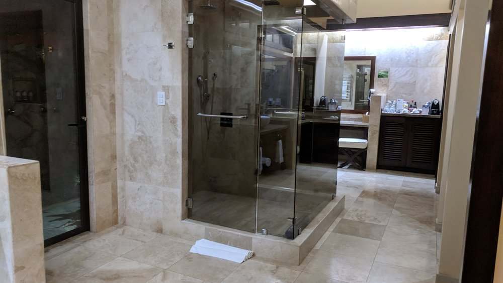 Another view of the shower along with the second sink and mini-bar area.