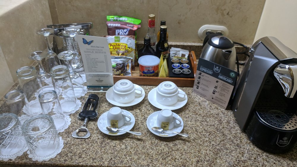 Glasses and snacks at the mini-bar. Everything was included in the room rate and refilled daily except the larger alcohol bottles in the middle at the top of the photo.