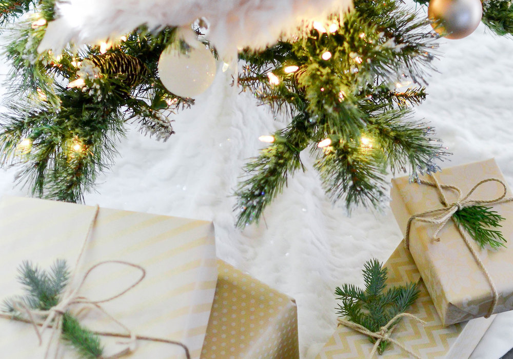 ellie's holiday gift guide. presents under Christmas tree.