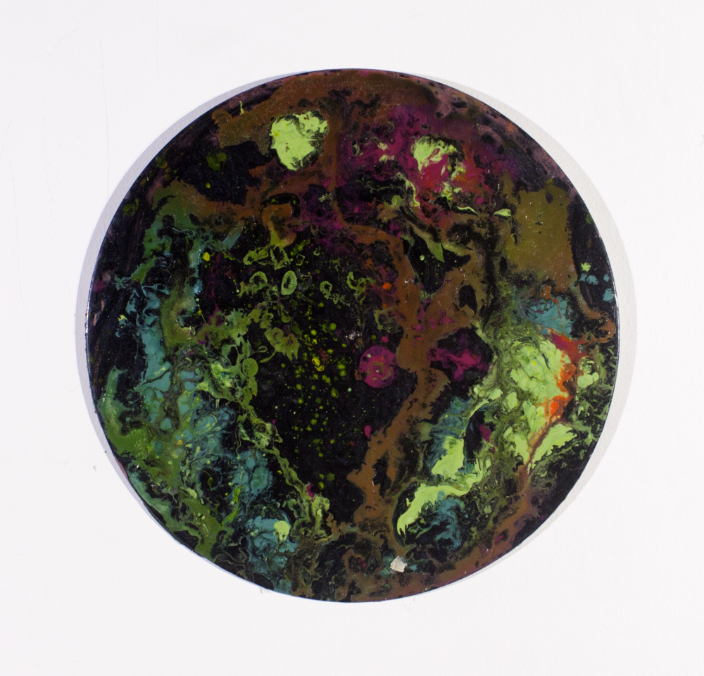 "Spills . 2016. Acrylic marbling on vinyl record. 12"" x 12""."