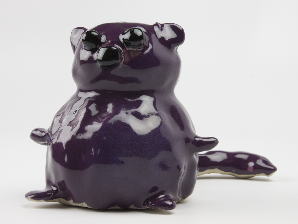 Plump Plum Squirrel . White stoneware clay, oxidation fired to Cone 5.
