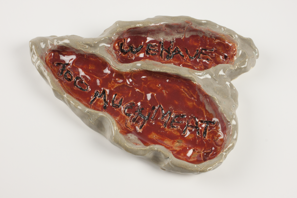 """We Have Too Much Meat.  White stoneware clay, commercial glazes, oxidation fired to Cone. 6. 8"""" x 5.75"""" x 1""""."""