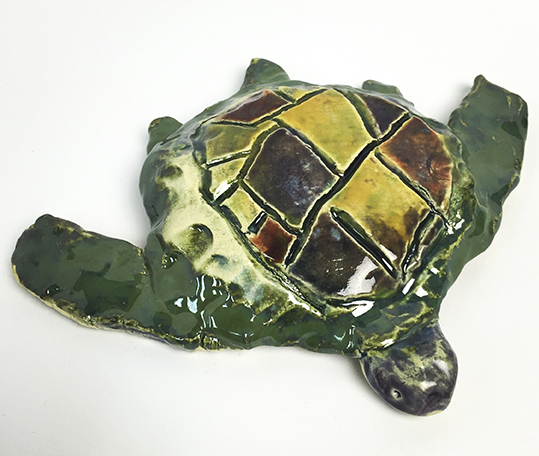 "Sea Turtle . White stoneware clay, oxidation fired to Cone 5. 7.5"" x 8.5"" 1.25"" (L x W x H)."