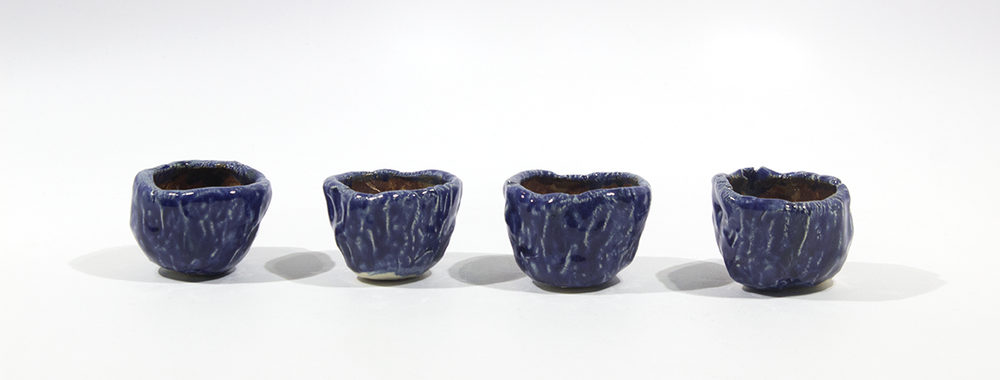 "Tea Cups.  Stoneware with commercial glazes. Approximately 2.25"" x 2.5"" x 2.25"" each."