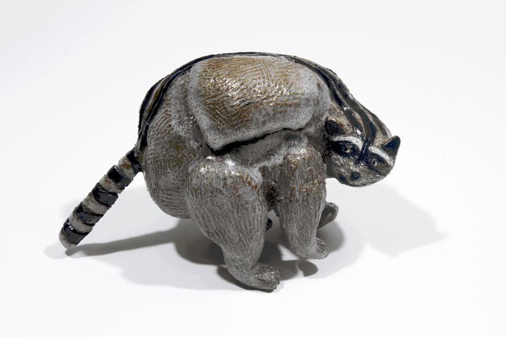 Raccoon Attack.  Stoneware with commercial glazes.