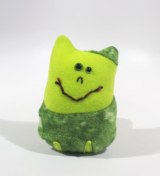 "Frog   Pot . 2019. Felt, beads, and yarn. 5"" x 2.5"" x 7""."