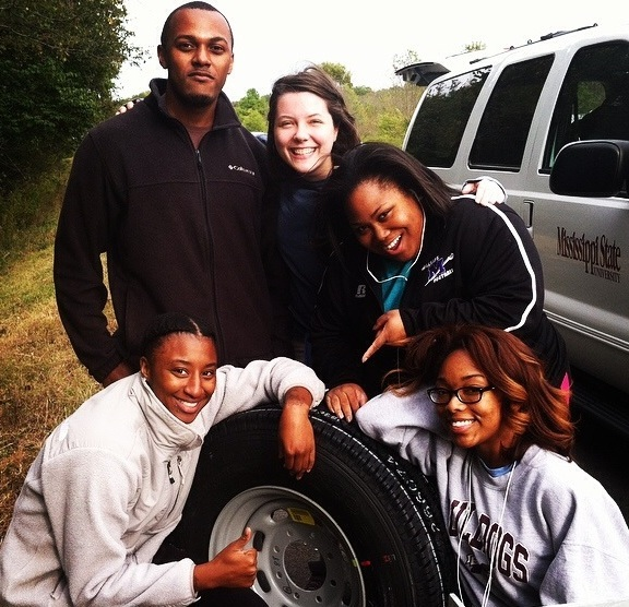 Students remain cheerful as Dr. Peterson panics about our tire blowout on I-40!