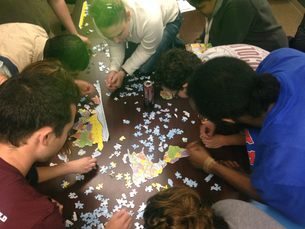Graduate students work on The Global Puzzle