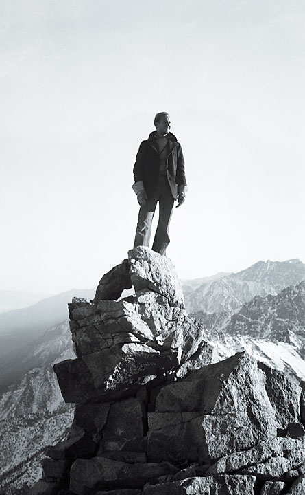 Fred Wilson, standing on a peak in the Sierra Nevada Mountains.