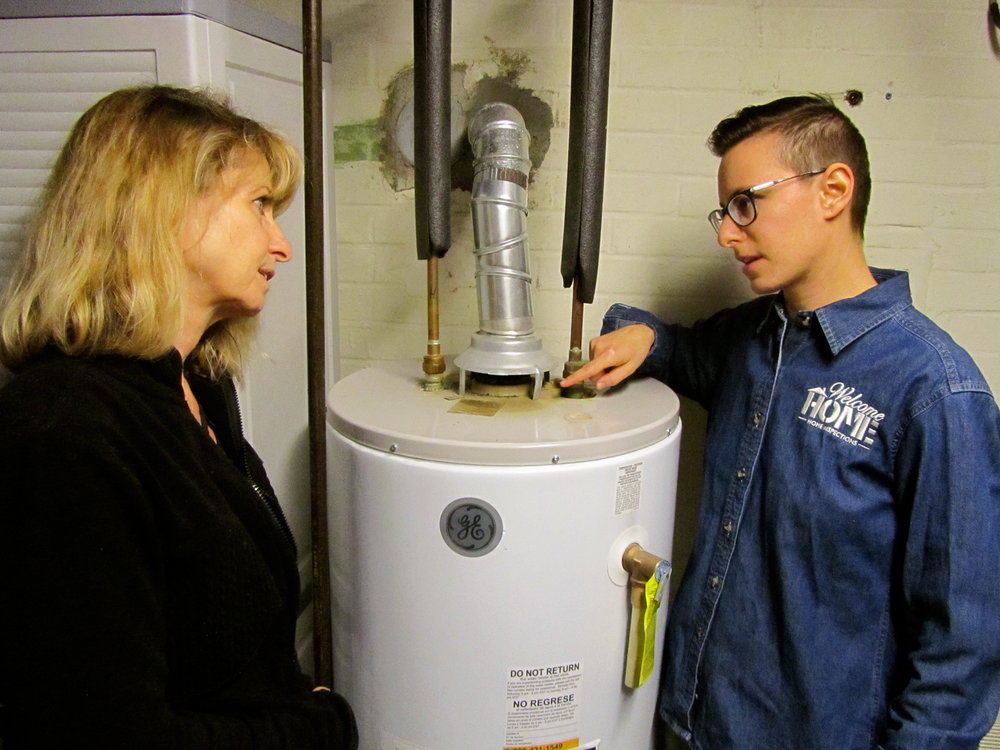 Describing the condition of flue backdrafting to the current home owner.