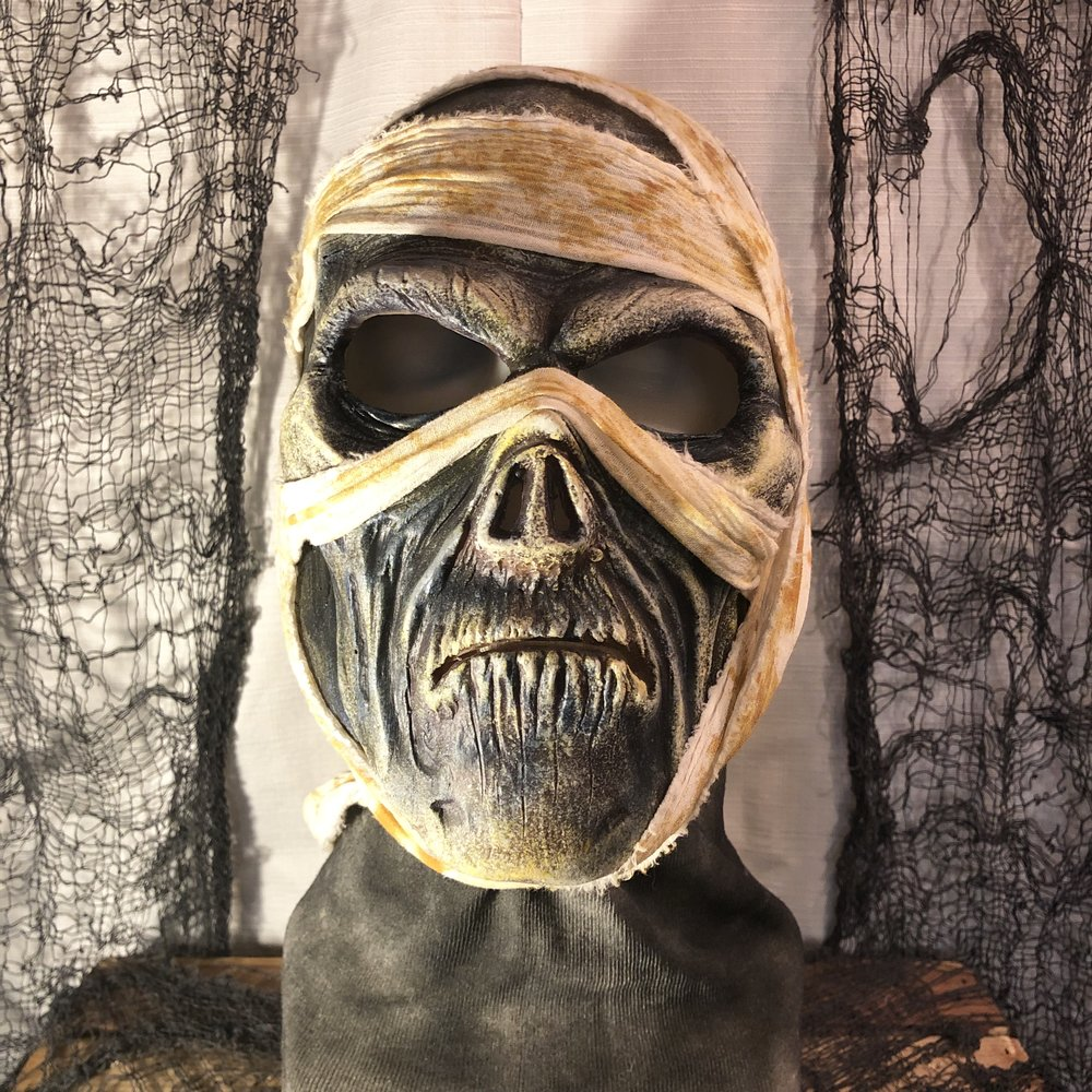 Mummy    $125.00   The Mummy is a full coverage sock mask and will fit most average sized adult heads. Care should be taken when being placed on and taken off the wearer's head as to not rip the fabric.  100% Natural Latex Mask and cotton fabric