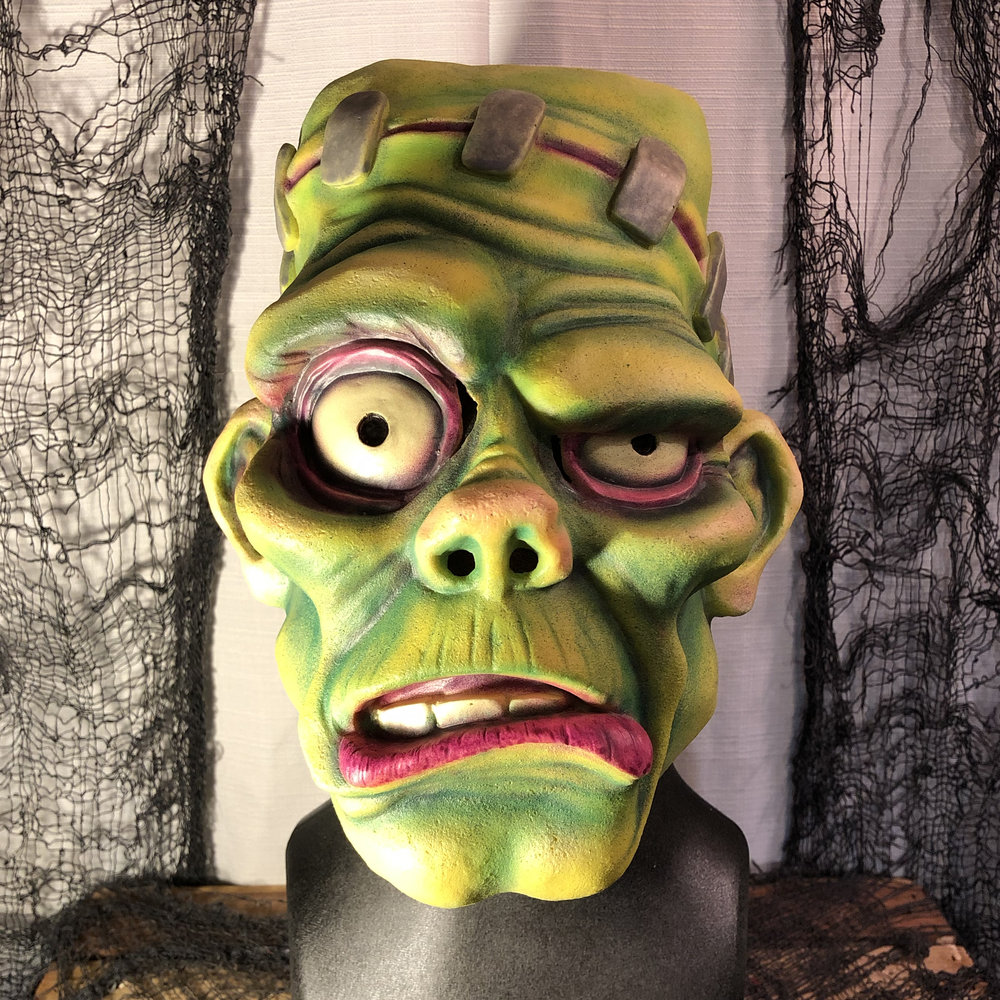 Frank  $125.00  Retro-modern take on the classic Frankenstein's Monster. Limited visibility, but still wearable. Great display piece. Hair optional.  100% Natural Latex Mask and hair