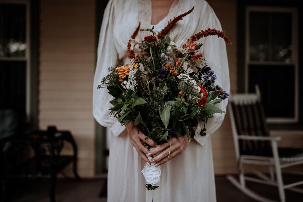 wildflower_bridal_bouquet_wrapped_in_lace_hankerchief.jpg