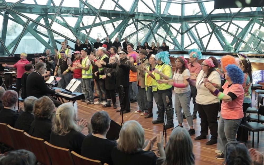 Choir of Hard Knocks performing Tattoo at Deakin Edge, Federation Square