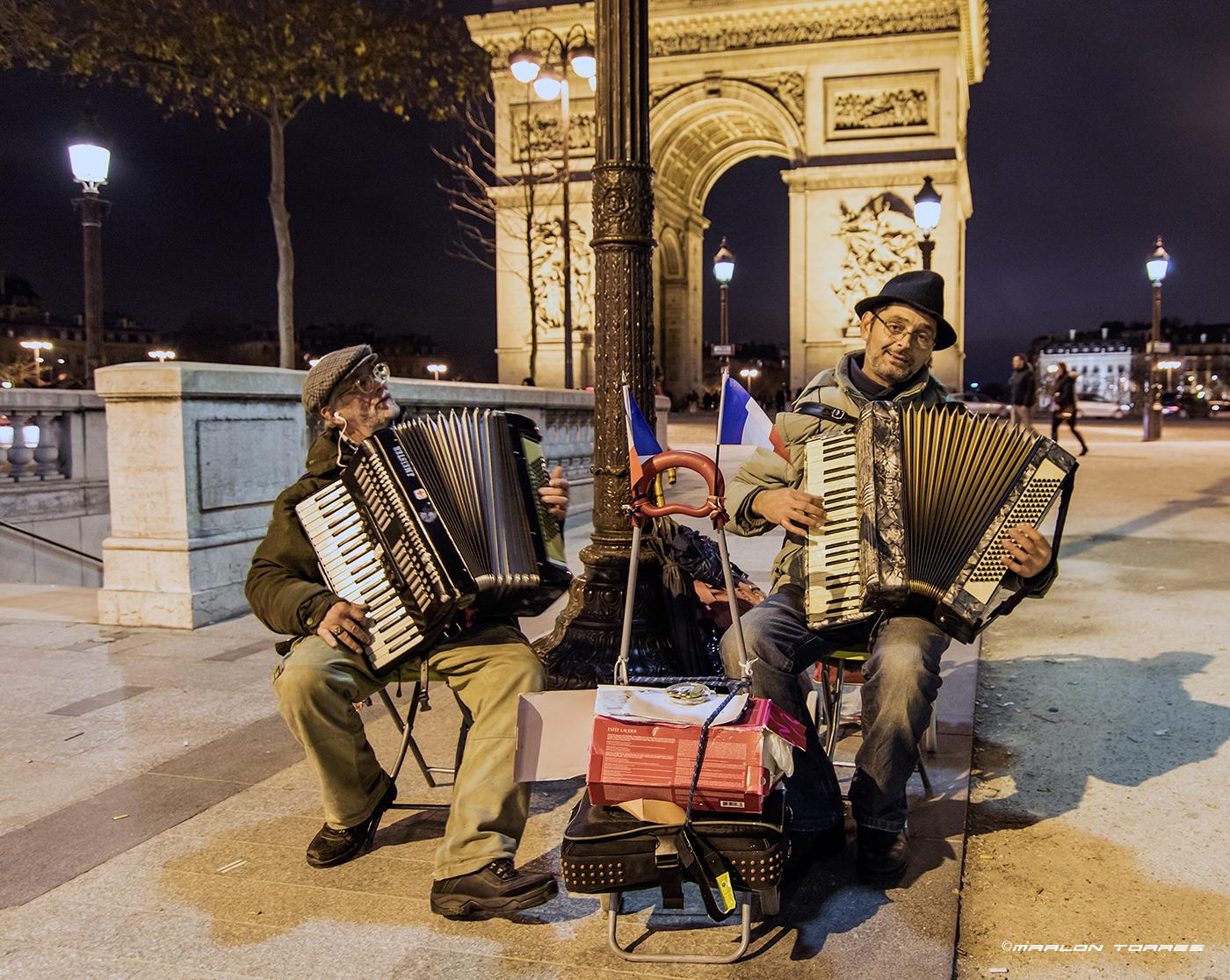 Frenchmen play La Vie en Rouge with their accordions. Photo: Marlon I. Torres
