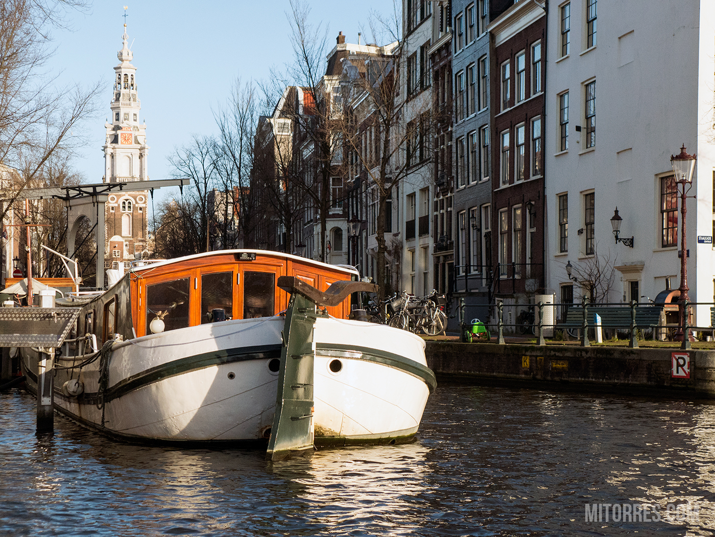 Beautiful canals and boats all around Amsterdam.