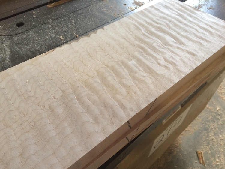 """The unique patterns in the grain of some bigleaf maple trees, known as """"figure"""", makes it highly valuable. The picture shows one such block of bigleaf maple wood after it's been processed at the mill. Photo credits: Anne Minden, Minden & Associates"""
